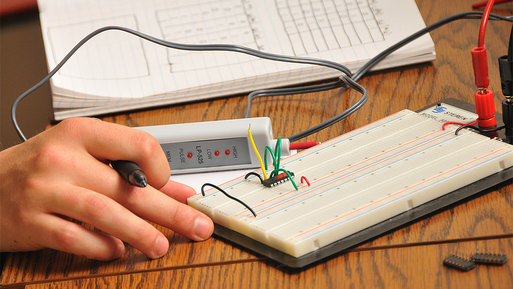 Student working on an electrical project in class