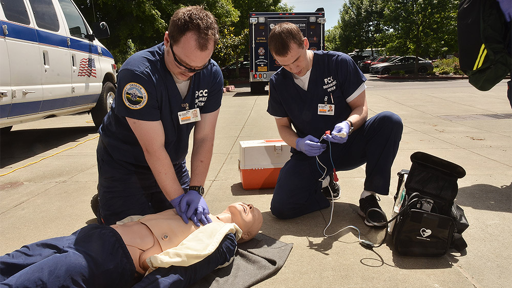 Students giving CPR to a dummy in a simulation