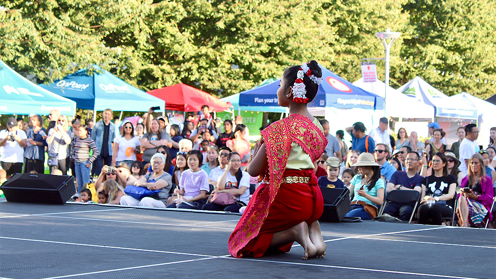Young girl performing an Asian dance