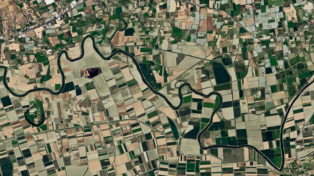 Aerial photograph of a river winding through farmland