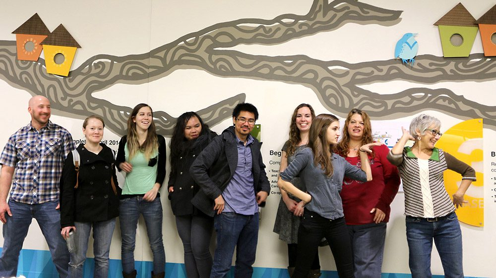 Students in front of a mural they designed at Sylvania Campus