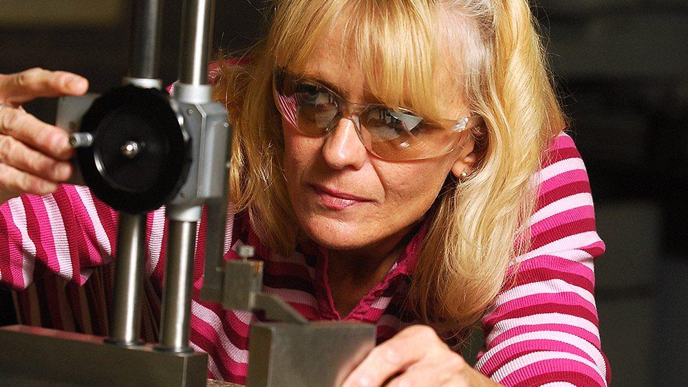 Student using machining equipment