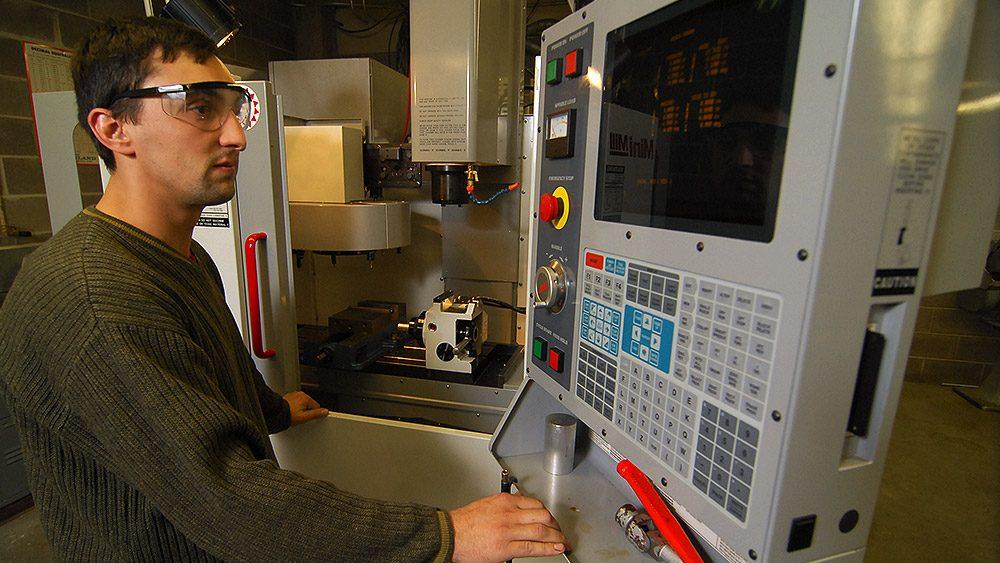 Student using machining computer