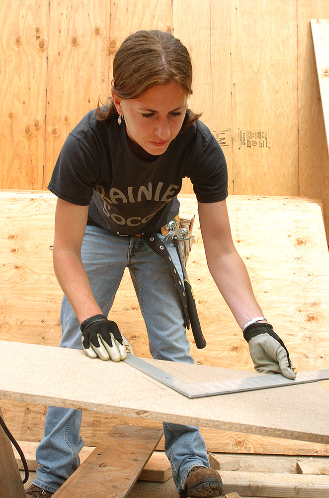 Woman working in building construction