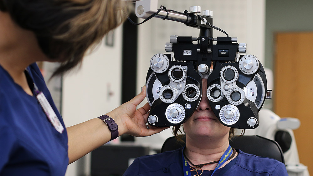 Student working with ophthalmic testing equipment