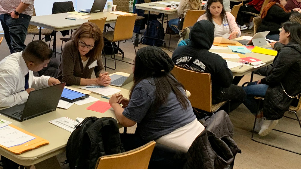 Paralegal students helping other students at a campus DACA workshop