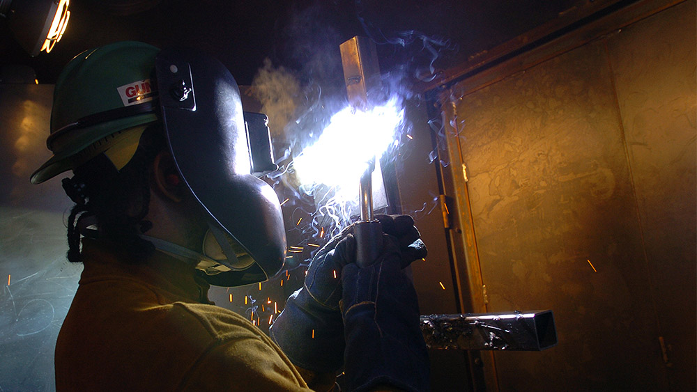 Student welding in the shop