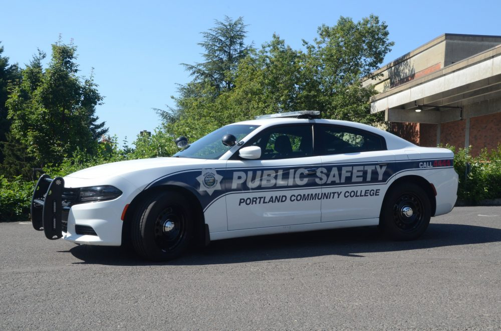 Public safety vehicle in front of trees