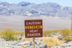 Photograph of sign that says Caution! Extreme Heat Danger
