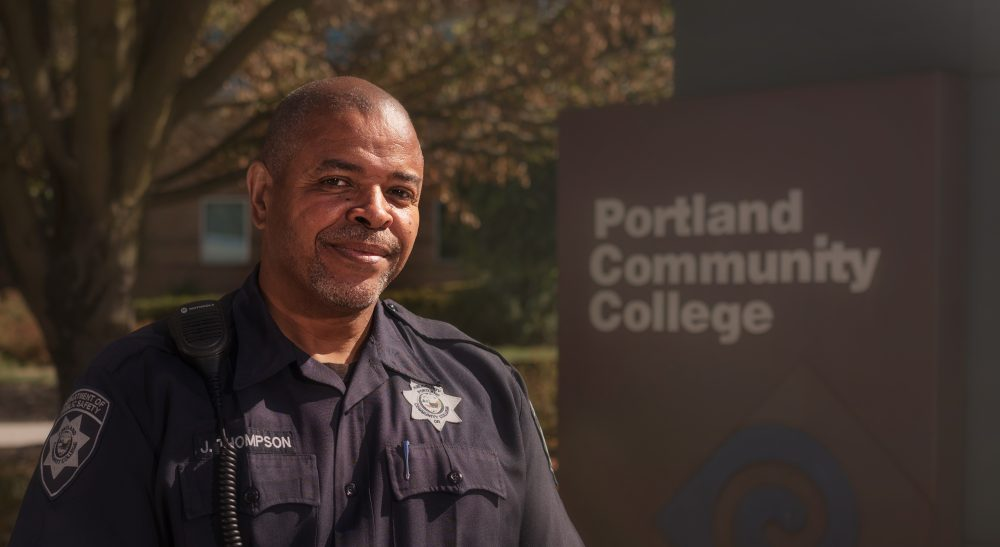 Officer standing by PCC sign