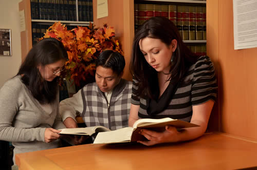 Paralegal students in law library