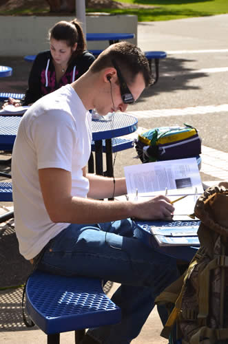 Students study on patio