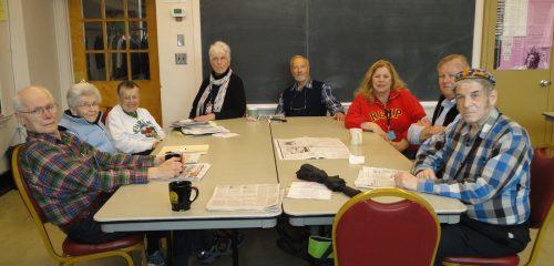 Senior Studies Institute particpants around a table