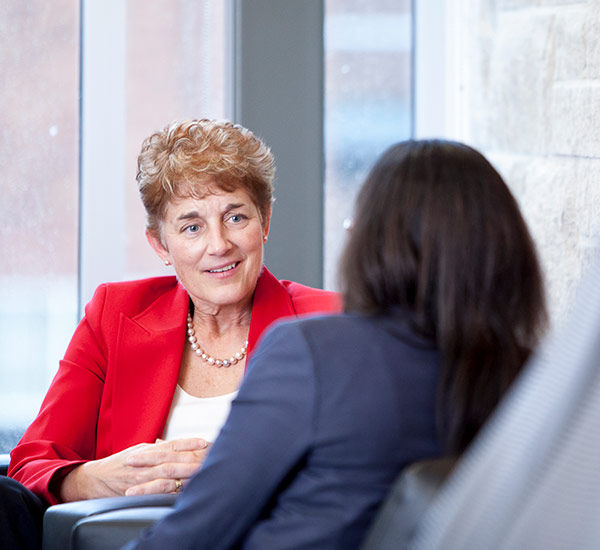Image shows two people conducting an interview in business attire.