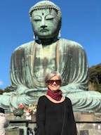 photo of Lippoldt standing in front of buddha