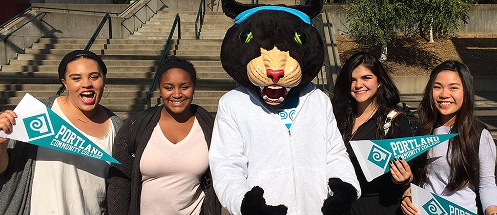 Poppie the Panther and students