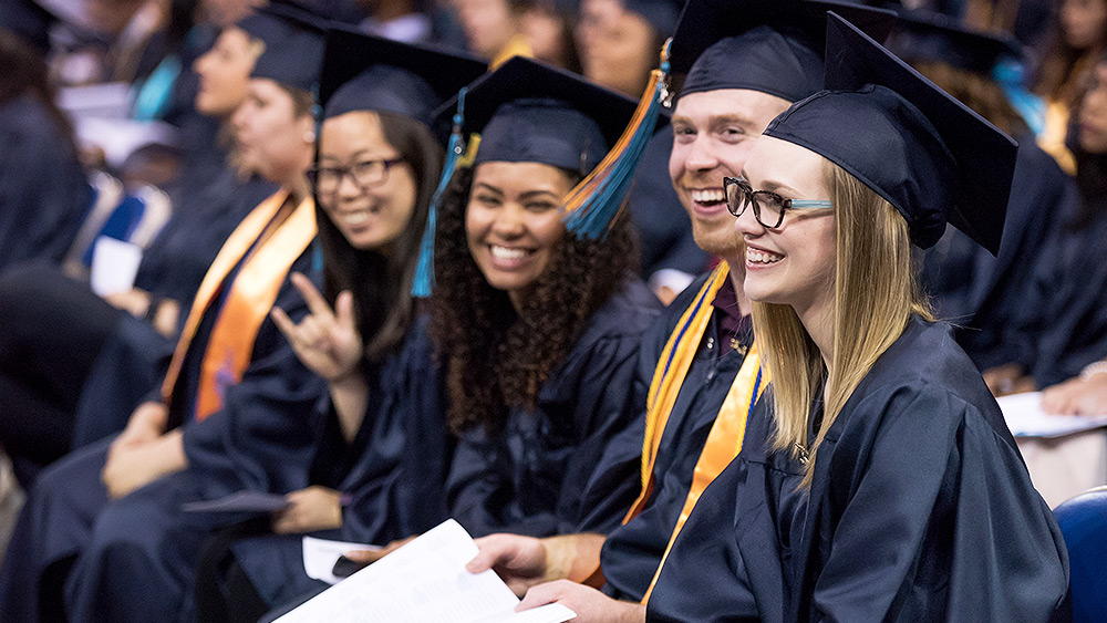 Students smiling at graudation