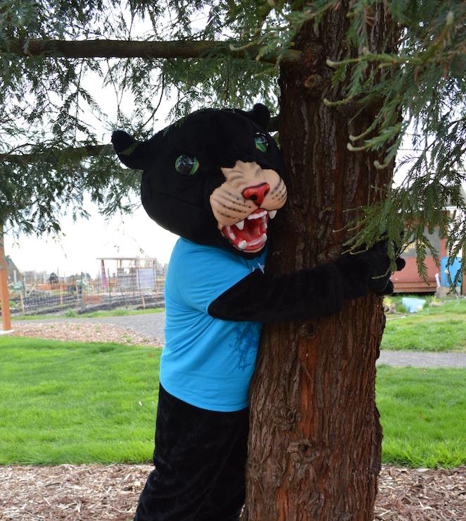Poppie hugging a tree