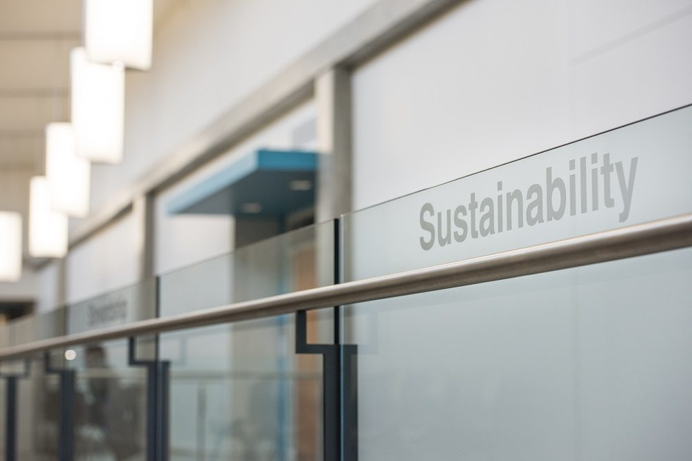 Sustainability text on glass railing