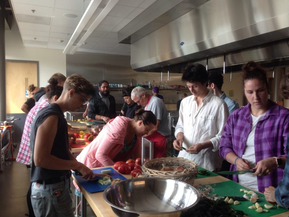 Students from Permaculture Design class making salsa with garden ingredients in the Food and Nutrition Lab in Bldg 5.