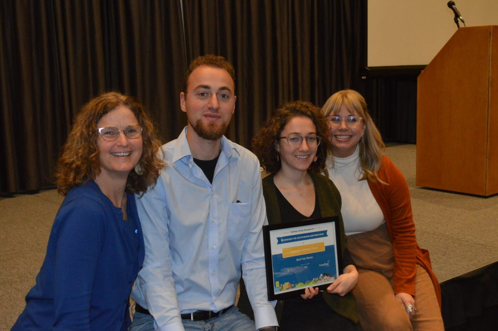 Sustainability Team members celebrate an award from the Energy Trust of Oregon