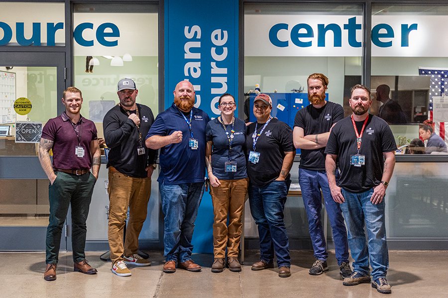 Seven VRC staff members range from flexing muscles to grinning hugs