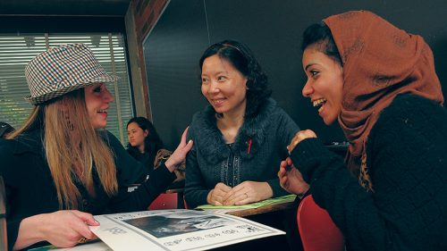 Group of three women talking and laughing together