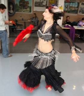 A Middle Eastern dancer entertains the lunch time crowd at the Cascade Campus during the 2008 International Education Week.