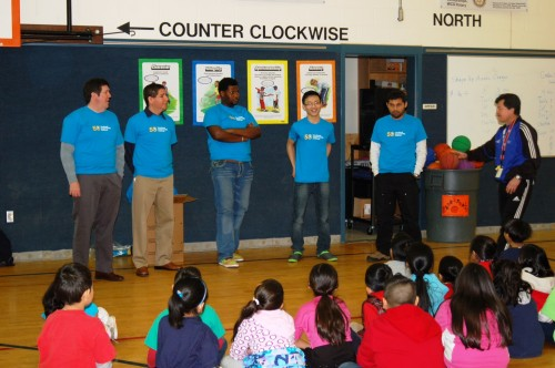 PCC students along with Southeast Interim President Craig Kolins (far left) talk to first and second graders at Adler Elementary for College Adoption Day.