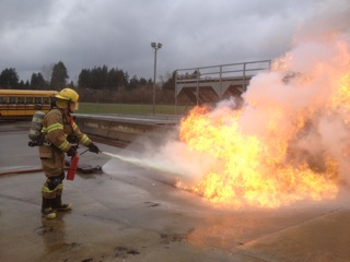 Trainees take part in a fire extinguisher drill at the Columbia County academy.