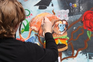 PCC Art Instructor Mark Smith creates a mural at last year's Art Beat Festival.