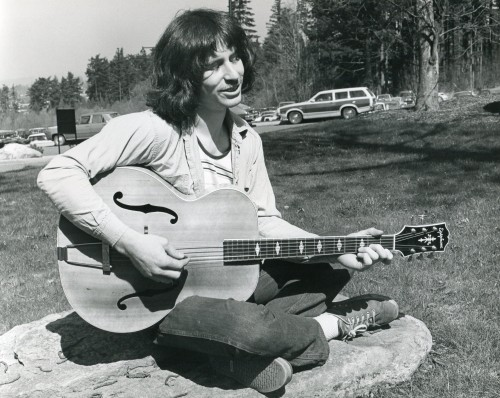 A student chills out on a Sylvania Campus lawn in the 1970s.