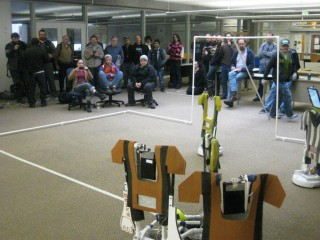 A large crowd gathers to witness Sylvania's first remotely-controlled robot soccer tournament.