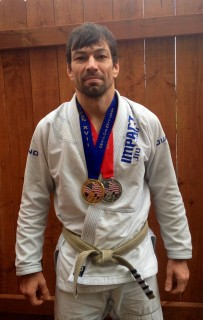 Richard Rangel, a part-time instructor in Sylvania's physical education department, proudly displays his gold and silver medals from the recent Brazilian Jiu-Jitsu U.S. Open tournament. In addition to teaching mixed martial arts at the college, he travels throughout the world to compete in Jiu-Jitsu competitions.