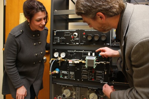 Electronic Engineering Technology Chair Sanda Williams and ClearEdge's Vice President of Engineering Tom Prevish inspect one of three Lab-Volt hydrogen fuel cell training systems that will be used for the new class.
