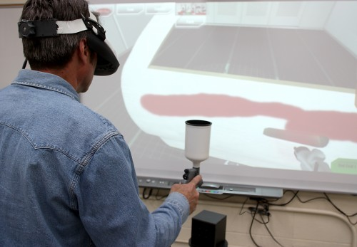 Geoff Snook, Auto Collision Repair instructor, demonstrates the virtual painting system.
