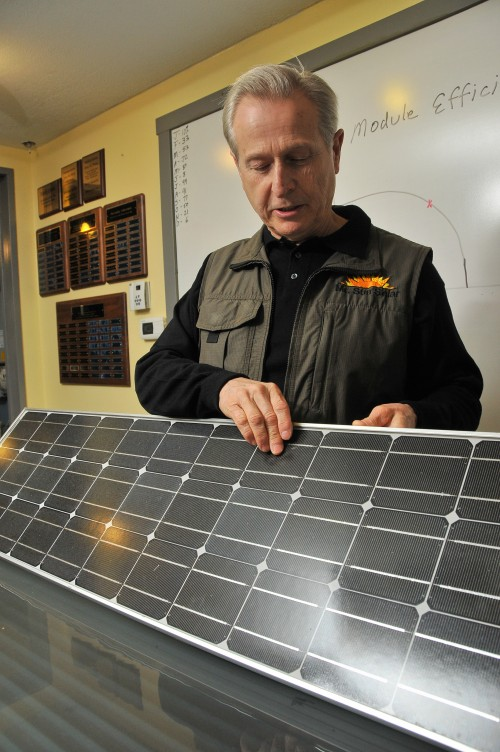 """""""Ever since I got into this business, part of my job has been educating people about solar energy,"""" said John Patterson, a former real estate agent who built a home in the 1970s using solar panels which set in motion his fascination with solar"""
