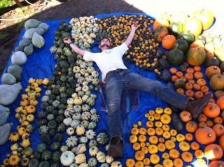 PCC's AmeriCorps team member Jeffery Mailes shows just the fun one can have with gourds and pumpkins.