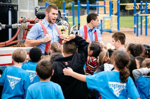 """Students Mitch Thornburg and Robert Williams """"show and tell"""" about the fire truck they use for training exercises at PCC."""