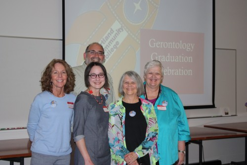 Gerontology Program community partners pose with Director Jan Abushakrah (second from right) at the 2014 completion ceremony.