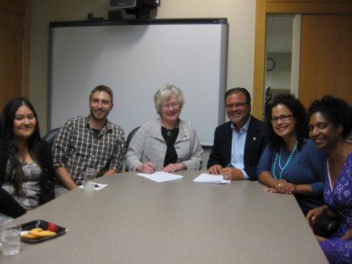 Signing the Memorandum of Understand are (left) Johanna Flores, Dreamer and PCC student; Kyle Pratuch, college resource coordinator for the Foundation; Sandra Fowler-Hill, president of the Rock Creek Campus; Mark Langseth, president & CEO of I Have A Dream Foundation; Brenda Ivelisse, associate dean of students at Rock Creek, and Traci Rossi, vice president for programs at the Foundation.