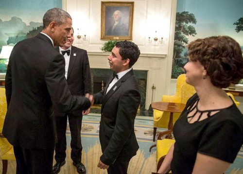 Victor Mena shakes President Barack Obama's hand during an immigration lobbying trip.