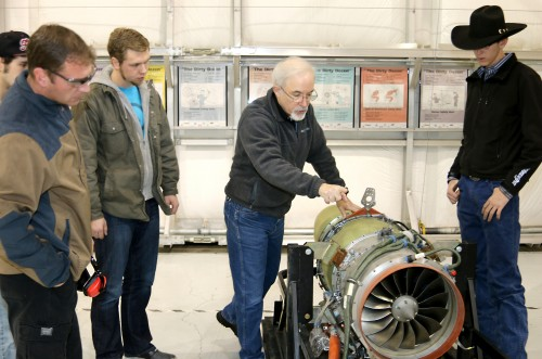 Aviation Maintenance Technology faculty Marshall Pryor (center) shows students, left to right, Edward Stravens, Michael Parkes and Jacob Rothgeb the new Williams International turbofan engine.