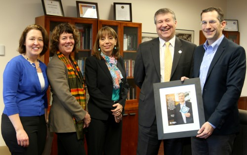 PCC President Jeremy Brown presents U.S. Sen. Jeff Merkley's Chief of Staff, Mike Zamore (far right), and his Education Policy Legislative Assistant, Susan Lexer (far left), a framed feature article honoring Sen. Merkley. Also on hand were, left to right, Traci Fordham (chief of staff) and Sylvia Kelley (vice president).