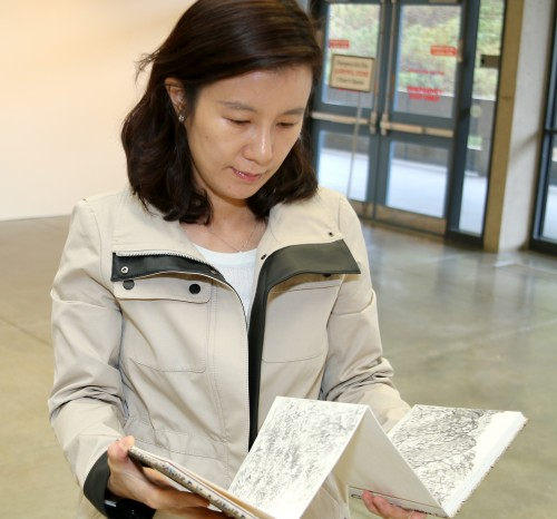 Soyoung Park will present traditional Korean folding books in her exhibit. The books feature panoramic paintings of Oregon landscapes. The sketchbook style is perfect for a movable viewpoint, versus the fixed point point of view typical of Western works.