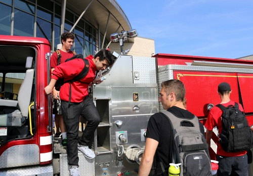 Liberty students test out their school's new fire truck. The engine is a 1997 KME fire engine (or pumper) that carries 1,000 gallons of water and can pump up to 1,250 gallons per minute.