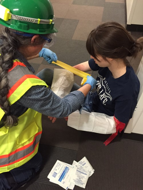 A C-CERT team member assists a 'victim' during the Cascade earthquake simulation.
