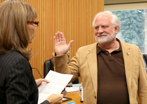 Michael Sonnleitner is sworn into service by Interim PCC President Sylvia Kelley in July. He has an extensive history of service not only at the college but within the community.