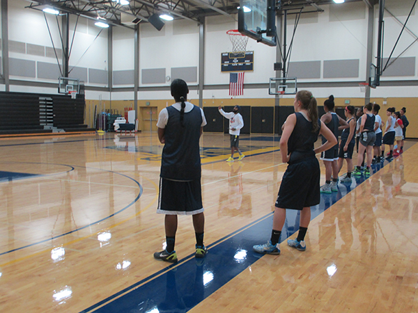 PCC's John Slaughter leads a women's basketball class at Cascade. The gym was recently given acoustic treatments and a new sound system.