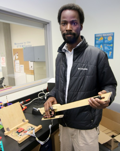In the STEM Center, he has a digital guitar he created from wood and panels of, wires, microprocessors and buttons that create sound.
